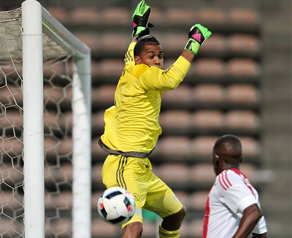 Goalkeeper Brandon Petersen of Ajax Cape Town misjudges a highball during the 2016 CAF Confederation Cup football match between Ajax Cape Town and Sagrada Esperanca at Athlone Stadium, Cape Town on 27 February 2016 ©Luigi Bennett/BackpagePix