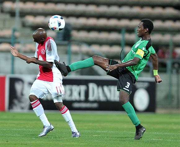 Bantu Mzwakali of Ajax Cape Town and Paulo Camufingo of Sagrada Esperanca during the 2016 CAF Confederation Cup football match between Ajax Cape Town and Sagrada Esperanca at Athlone Stadium, Cape Town on 27 February 2016 ©Luigi Bennett/BackpagePix