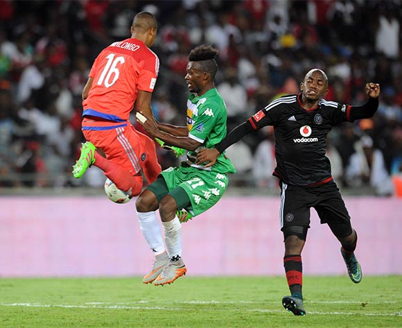 Patrick Phungwayo of Orlando Pirates(r) and Brighton Mhlongo of Orlando Pirates (l) challenge Fiston Abdoul of Bloemfontein Celtic during the Absa Premiership match between Orlando Pirates and Bloemfontein  Celtic  on 27 February 2016 at Orlando Stadium Pic Sydney Mahlangu/ BackpagePix