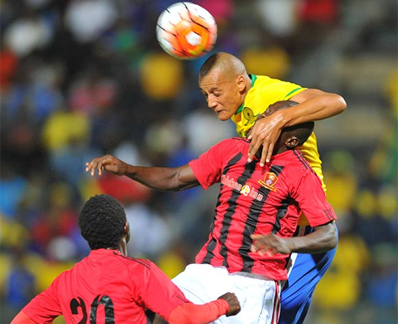 Wayne Arendse (b) of Mamelodi Sundowns challenged by Moses Jackson (f) of Chicken Inn during the 2016 CAF Champions League football match between Mamelodi Sundowns and Chicken Inn at the Lucas Moripe Stadium in Pretoria, South Africa on February 27, 2016 ©Samuel Shivambu/BackpagePix