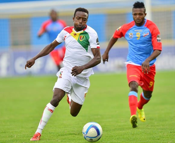 Alseny Bangoura of Guinea gets away from Christian Ngudikama of DR Congo during the 2016 CHAN semifinal football match between DR Congo and Guinea at the Amahoro Stadium in Kigali, Rwanda on 03 February 2016 ©Gavin Barker/BackpagePix