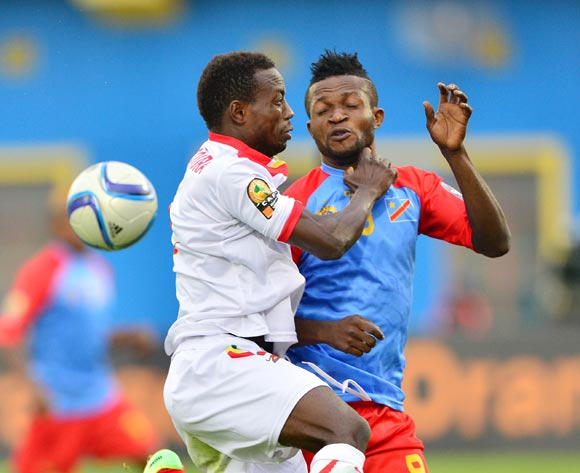 Alseny Bangoura of Guinea and  Christian Ngudikama of DR Congo challenge for the ball during the 2016 CHAN semifinal football match between DR Congo and Guinea at the Amahoro Stadium in Kigali, Rwanda on 03 February 2016 ©Gavin Barker/BackpagePix