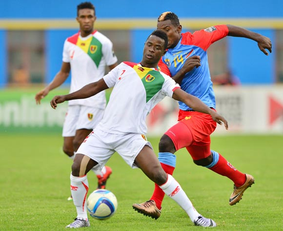 Mohamed Thiam of Guinea shields ball from Nelson Munganga Omba of DR Congo during the 2016 CHAN semifinal football match between DR Congo and Guinea at the Amahoro Stadium in Kigali, Rwanda on 03 February 2016 ©Gavin Barker/BackpagePix