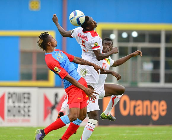 Alseny Bangoura of Guinea heads ball away from Jonathan Bolingi of DR Congo during the 2016 CHAN semifinal football match between DR Congo and Guinea at the Amahoro Stadium in Kigali, Rwanda on 03 February 2016 ©Gavin Barker/BackpagePix