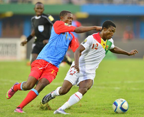 Aboubacar Sylla of Guinea shields ball from Doxa Gikanji of DR Congo during the 2016 CHAN semifinal football match between DR Congo and Guinea at the Amahoro Stadium in Kigali, Rwanda on 03 February 2016 ©Gavin Barker/BackpagePix