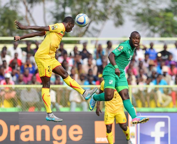 Abdoul Karim Dante of Mali wins header against  Franck Djedje Guiza of Ivory Coast during the 2016 CHAN semifinal football match between Mali and Ivory Coast at the Stade de Kigali in Kigali, Rwanda on 04 February 2016 ©Gavin Barker/BackpagePix