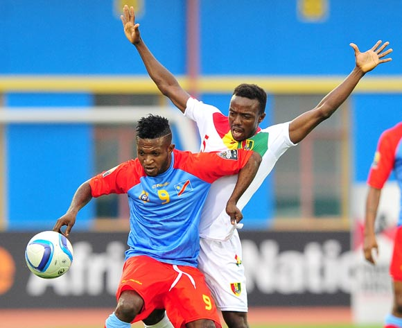 Christian Ngudikama of DR Congo is challenged by Alsény Bangoura of Guinea during the 2016 CHAN Rwanda semifinal game between DR Congo and Guinea at Amahoro Stadium, Kigali on 3 February 2016 ©Ryan Wilkisky/BackpagePix