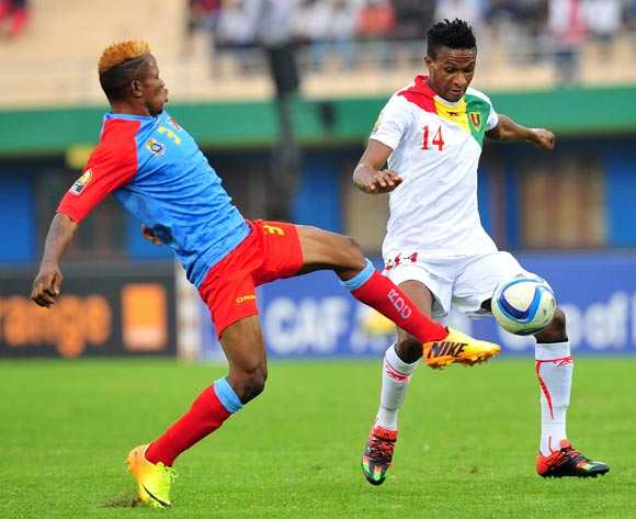 Jean Mouste of Guinea is challenged by Lomalisa Mutambala of DR Congo during the 2016 CHAN Rwanda semifinal game between DR Congo and Guinea at Amahoro Stadium, Kigali on 3 February 2016 ©Ryan Wilkisky/BackpagePix
