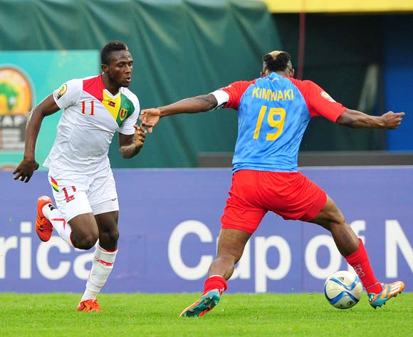 Moussa Diawara of Guinea takes on Joel Kimwaki of DR Congo during the 2016 CHAN Rwanda semifinal game between DR Congo and Guinea at Amahoro Stadium, Kigali on 3 February 2016 ©Ryan Wilkisky/BackpagePix
