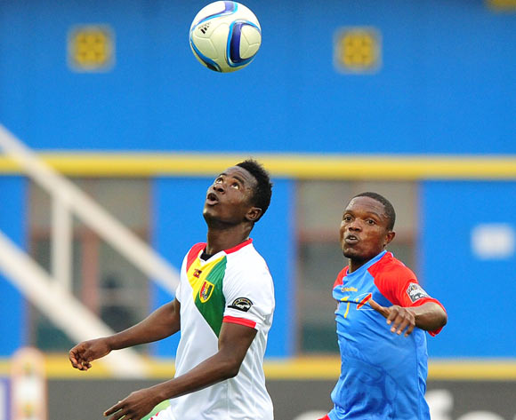 Mohamed Thiam of Guinea controls the ball as he is challenged by Doxa Gikanji of DR Congo during the 2016 CHAN Rwanda semifinal game between DR Congo and Guinea at Amahoro Stadium, Kigali on 3 February 2016 ©Ryan Wilkisky/BackpagePix