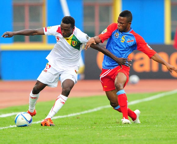 Alsény Bangoura of Guinea is challenged by Meschak Elia of DR Congo during the 2016 CHAN Rwanda semifinal game between DR Congo and Guinea at Amahoro Stadium, Kigali on 3 February 2016 ©Ryan Wilkisky/BackpagePix
