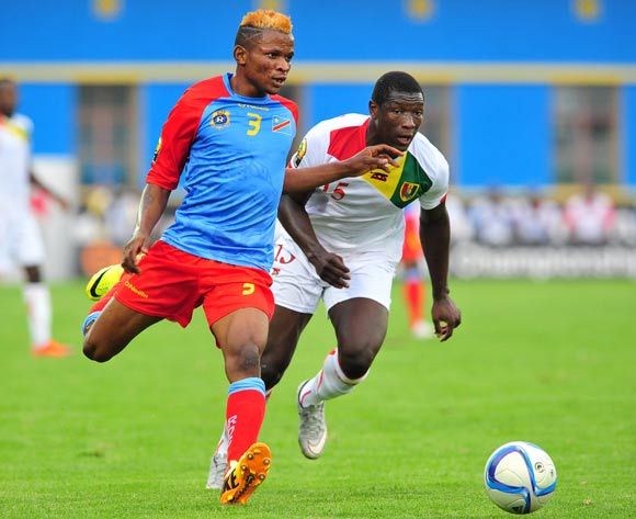 Lomalisa Mutambala of DR Congo is challenged by Alseny Camara of Guinea during the 2016 CHAN Rwanda semifinal game between DR Congo and Guinea at Amahoro Stadium, Kigali on 3 February 2016 ©Ryan Wilkisky/BackpagePix