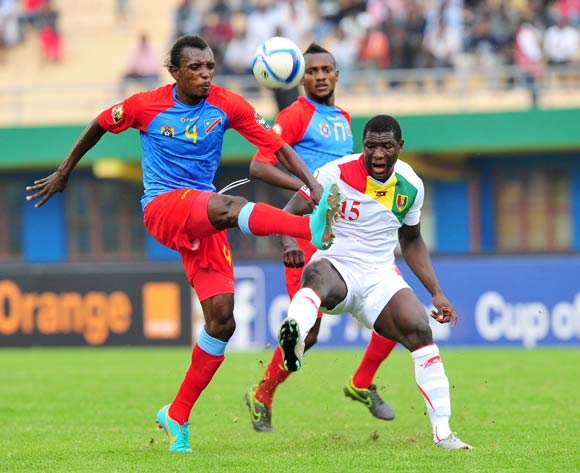 Padoue Bompunga of DR Congo clears the ball ahead of Alseny Camara of Guinea during the 2016 CHAN Rwanda semifinal game between DR Congo and Guinea at Amahoro Stadium, Kigali on 3 February 2016 ©Ryan Wilkisky/BackpagePix