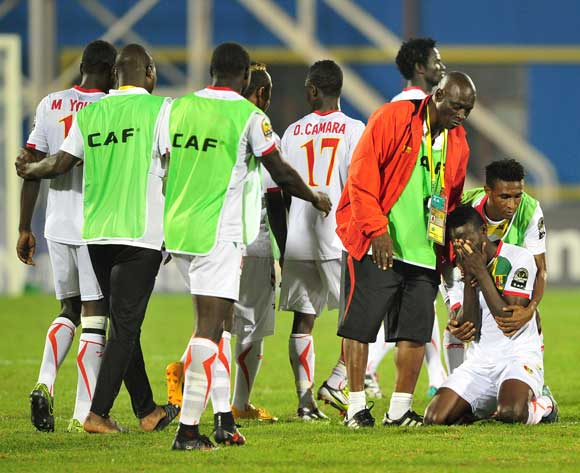 Guinea players react in disappointment after losing in the penalty shoot out during the 2016 CHAN Rwanda semifinal game between DR Congo and Guinea at Amahoro Stadium, Kigali on 3 February 2016 ©Ryan Wilkisky/BackpagePix