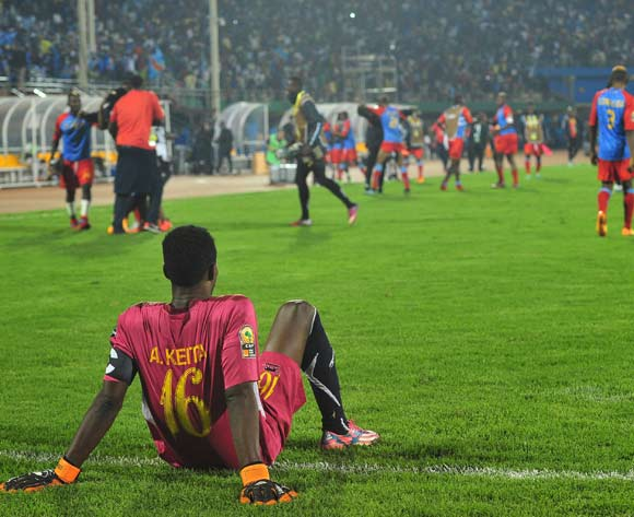 Abdoul Aziz Keita of Guinea sits dejected after losing in a penalty shoot out during the 2016 CHAN Rwanda semifinal game between DR Congo and Guinea at Amahoro Stadium, Kigali on 3 February 2016 ©Ryan Wilkisky/BackpagePix