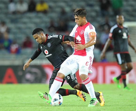 Thandani Ntshumayelo of Orlando Pirates is challenged by Travis Graham of Ajax Cape Town during the Absa Premiership match between Orlando Pirates and Ajax Cape Town  on 03 February 2016 at Orlando Stadium Pic Sydney Mahlangu/ BackpagePix