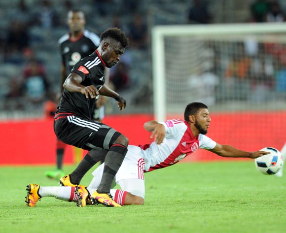 Edwin Gyimah of Orlando Pirates challenges Riyaad Norodien of Ajax Cape Town during the Absa Premiership match between Orlando Pirates and Ajax Cape Town  on 03 February 2016 at Orlando Stadium Pic Sydney Mahlangu/ BackpagePix