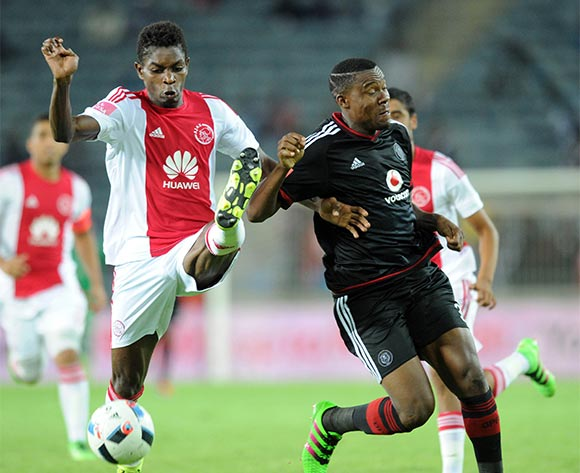 Lawrence Lartley of Ajax Cape Town challenges  Thamsanqa Gabuza of Orlando Pirates during the Absa Premiership match between Orlando Pirates and Ajax Cape Town  on 03 February 2016 at Orlando Stadium Pic Sydney Mahlangu/ BackpagePix