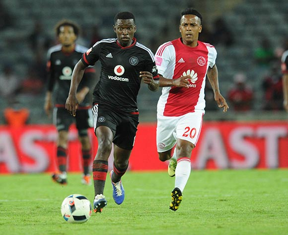 Erwin Isaacs of Ajax Cape Town challenges  Sifiso Myeni of Orlando Pirates during the Absa Premiership match between Orlando Pirates and Ajax Cape Town  on 03 February 2016 at Orlando Stadium Pic Sydney Mahlangu/ BackpagePix