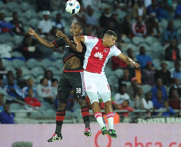 Gift Motupa of Orlando Pirates challenges Toriq Losper of Ajax Cape Town during the Absa Premiership match between Orlando Pirates and Ajax Cape Town  on 03 February 2016 at Orlando Stadium Pic Sydney Mahlangu/ BackpagePix