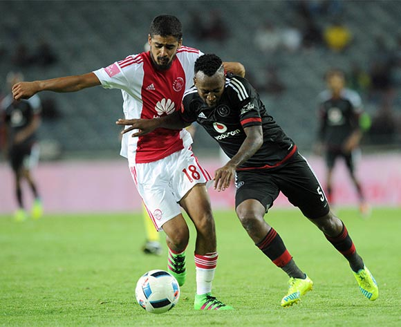 Mpho Makola of Orlando Pirates is challenged by Abbubaker Mobara of Ajax Cape Town during the Absa Premiership match between Orlando Pirates and Ajax Cape Town  on 03 February 2016 at Orlando Stadium Pic Sydney Mahlangu/ BackpagePix