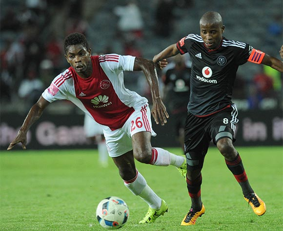 Lawrence Lartley of Ajax Cape Town challenges  Thabo Matlaba of Orlando Pirates during the Absa Premiership match between Orlando Pirates and Ajax Cape Town  on 03 February 2016 at Orlando Stadium Pic Sydney Mahlangu/ BackpagePix