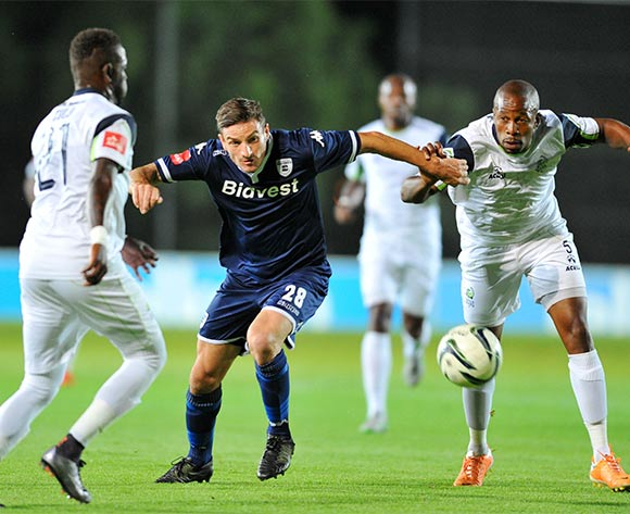 James Keene of Bidvest Wits challenged by Sibusiso Zulu and Gift Sithole of Platinum Stars during the Absa Premiership match between Bidvest Wits and Platinum Stars at the Bidvest Stadium in Johannesburg, South Africa on February 03, 2016 ©Samuel Shivambu/BackpagePix