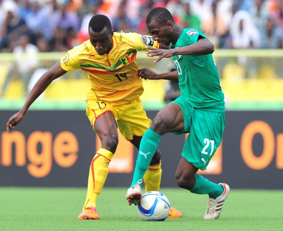 Cheick Ibrahim Comara of Ivory Coast is challenged by Abdoulaye Diarra of Mali during the 2016 CHAN Rwanda semifinal game between Mali and Ivory Coast at Stade de Kigali, Kigali, Rwanda on 4 February 2016 ©Ryan Wilkisky/BackpagePix