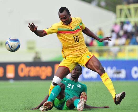 Mamadou Coulibaly of Mali is tackled by Cheick Ibrahim Comara of Ivory Coast during the 2016 CHAN Rwanda semifinal game between Mali and Ivory Coast at Stade de Kigali, Kigali, Rwanda on 4 February 2016 ©Ryan Wilkisky/BackpagePix