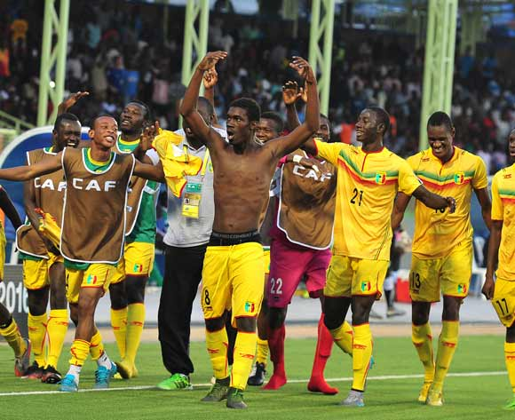 Mali players celebrate with goalscorer Yves Bissouma, (shirt off) during the 2016 CHAN Rwanda semifinal game between Mali and Ivory Coast at Stade de Kigali, Kigali, Rwanda on 4 February 2016 ©Ryan Wilkisky/BackpagePix