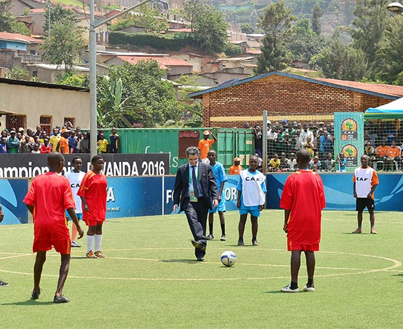CAF Secretary General Hicham El Amrani kicks off match during the Kigali Football for Good Festival at the Kimisagara Football for Hope Centre in Kigali, Rwanda on 06 February 2016 ©Gavin Barker/BackpagePix