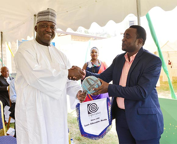 Victor Emmanuel Sewabana from Esperance Kigali awarded  gift to CAF Vice President Almamy Kabele Camara during the Kigali Football for Good Festival at the Kimisagara Football for Hope Centre in Kigali, Rwanda on 06 February 2016 ©Gavin Barker/BackpagePix