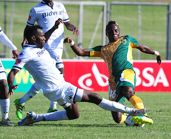 Mahachi Kudakwashe of Golden Arrows tackled by Bongani Khumalo of Bidvest Wits during the Absa Premiership 2015/16 match between Golden Arrows and Bidvest Wits in Chatsworth Stadium Durban, Kwa-Zulu Natal on 06 February 2016 ©Muzi Ntombela/BackpagePix
