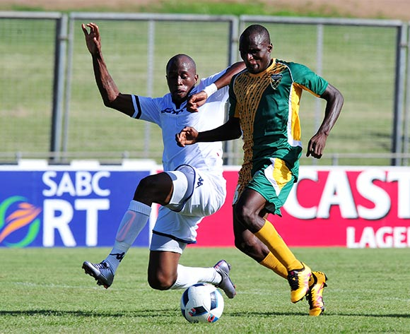 Rodney Ramagalela of Golden Arrows tackled by Sfiso Hlanti of Bidvest Wits during the Absa Premiership 2015/16 match between Golden Arrows and Bidvest Wits in Chatsworth Stadium Durban, Kwa-Zulu Natal on 06 February 2016 ©Muzi Ntombela/BackpagePix