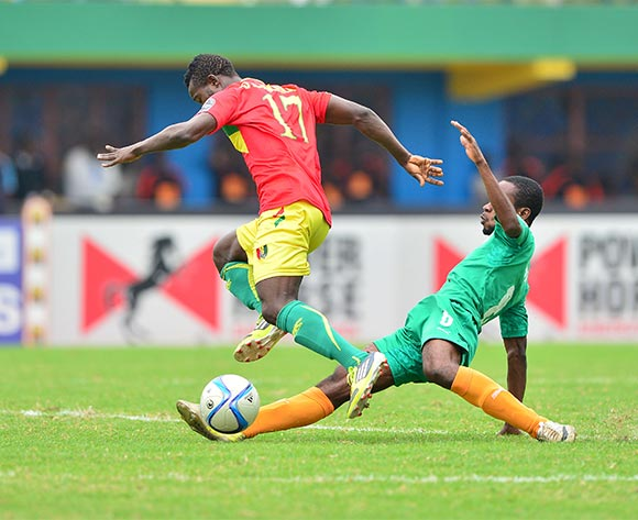 Boniface Haba of Guinea fouled by Gbagnon Anicet Badie of Ivory Coast during the 2016 CHAN Rwanda 3rd Place Playoff game between Guinea and Ivory Coast at the Amahoro Stadium in Kigali, Rwanda on 07 February 2016 ©Gavin Barker/BackpagePix