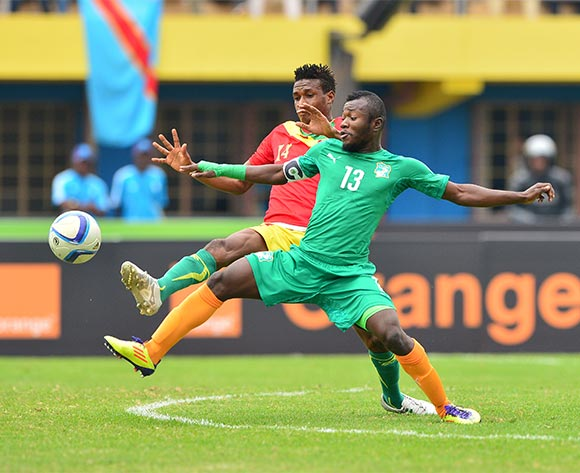 Yao Serge Nguessan of Ivory Coast challenged by Jean Mouste of Guinea during the 2016 CHAN Rwanda 3rd Place Playoff game between Guinea and Ivory Coast at the Amahoro Stadium in Kigali, Rwanda on 07 February 2016 ©Gavin Barker/BackpagePix