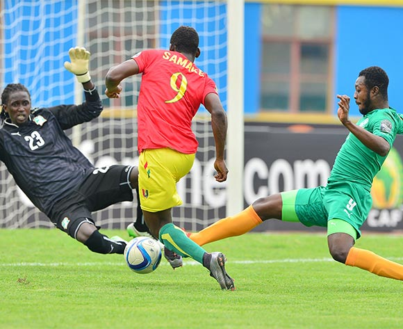 Abdulaye Samake of Guinea fouled by Abdoul Karim Cisse (keeper) and Adama Kangoute of Ivory Coast awarded penalty during the 2016 CHAN Rwanda 3rd Place Playoff game between Guinea and Ivory Coast at the Amahoro Stadium in Kigali, Rwanda on 07 February 2016 ©Gavin Barker/BackpagePix