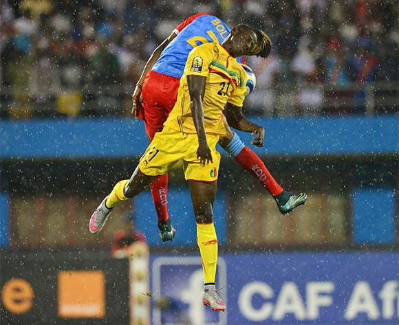 Abdoul Karim Dante of Mali wins header against  Jonathan Bolingi of DR Congo during the 2016 CHAN Rwanda Final between DR Congo and Mali at the Amahoro Stadium in Kigali, Rwanda on 07 February 2016 ©Gavin Barker/BackpagePix