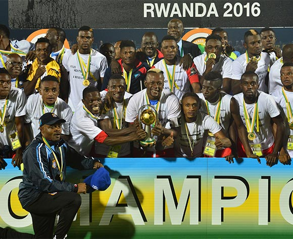 Joel Kimwaki of DR Congo holds aloft the trophy during the 2016 CHAN Rwanda Final between DR Congo and Mali at the Amahoro Stadium in Kigali, Rwanda on 07 February 2016 ©Gavin Barker/BackpagePix