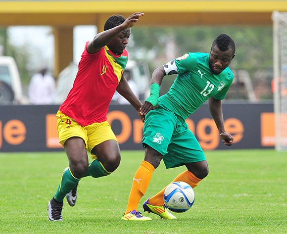 Yao Serge Nguessan of Ivory Coast is challenged by Abdulaye Samake of Guinea during the 2016 CHAN Rwanda 3rd Place Playoff game between Guinea and Ivory Coast at the Amahoro Stadium in Kigali, Rwanda on 07 February 2016 ©Ryan Wilkisky/BackpagePix
