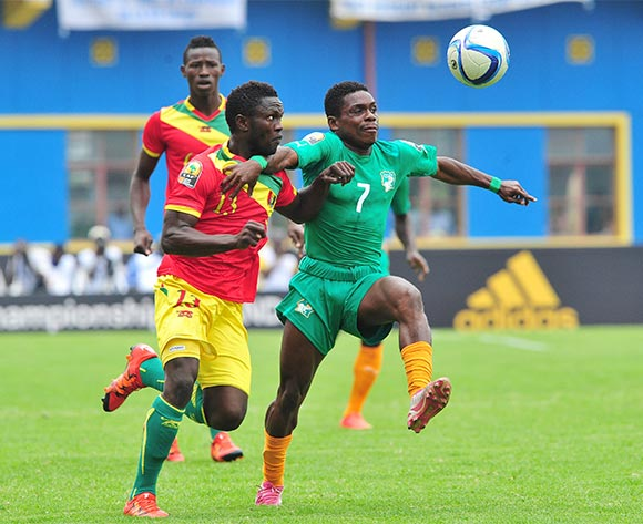 Djobo Atcho of Ivory Coast is challenged by Alseny Camara of Guinea during the 2016 CHAN Rwanda 3rd Place Playoff game between Guinea and Ivory Coast at the Amahoro Stadium in Kigali, Rwanda on 07 February 2016 ©Ryan Wilkisky/BackpagePix