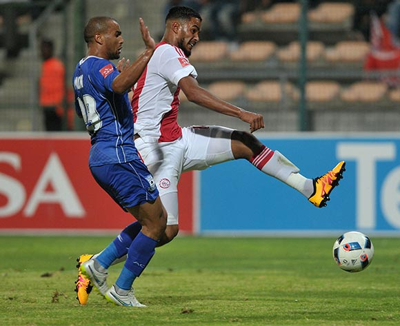 Tashreeq Morris of Ajax Cape Town evades challenge from Bryce Moon of Black Aces during the Absa Premiership 2015/16 football match between Ajax Cape Town and Black Aces at Athlone Stadium, Cape Town on 10 February 2016 ©Chris Ricco/BackpagePix