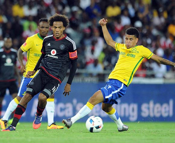 Issa Sarr of Orlando Pirates is challenged Keagan Dolly of Mamelodi Sundowns during the Absa Premiership match between Orlando Pirates and Mamelodi Sundowns  on 10 February 2016 at Orlando Stadium Pic Sydney Mahlangu/ BackpagePix