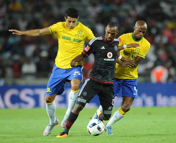 Thabo Rakhale of Orlando Pirates is challenged by Leonardo Castro of Mamelodi Sundowns (l) and Tebogo Langerman of Mamelodi Sundowns during the Absa Premiership match between Orlando Pirates and Mamelodi Sundowns  on 10 February 2016 at Orlando Stadium Pic Sydney Mahlangu/ BackpagePix