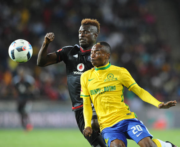 Edwin Gyimah of Orlando Pirates challenges Khama Billiat of Mamelodi Sundowns during the Absa Premiership match between Orlando Pirates and Mamelodi Sundowns  on 10 February 2016 at Orlando Stadium Pic Sydney Mahlangu/ BackpagePix
