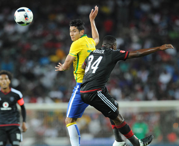 Leonardo Castro of Mamelodi Sundowns is challenged by Ntsikelelo Nyauza of Orlando Pirates   during the Absa Premiership match between Orlando Pirates and Mamelodi Sundowns  on 10 February 2016 at Orlando Stadium Pic Sydney Mahlangu/ BackpagePix