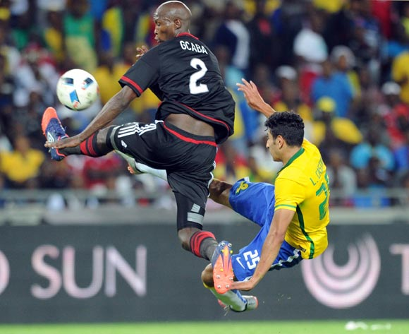 Leonardo Castro of Mamelodi Sundowns is challenged by Ayanda Gcaba of Orlando Pirates   during the Absa Premiership match between Orlando Pirates and Mamelodi Sundowns  on 10 February 2016 at Orlando Stadium Pic Sydney Mahlangu/ BackpagePix
