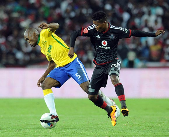 Asavela Mbekile of Mamelodi Sundowns challenges Menzi Masuku of Orlando Pirates during the Absa Premiership match between Orlando Pirates and Mamelodi Sundowns  on 10 February 2016 at Orlando Stadium Pic Sydney Mahlangu/ BackpagePix