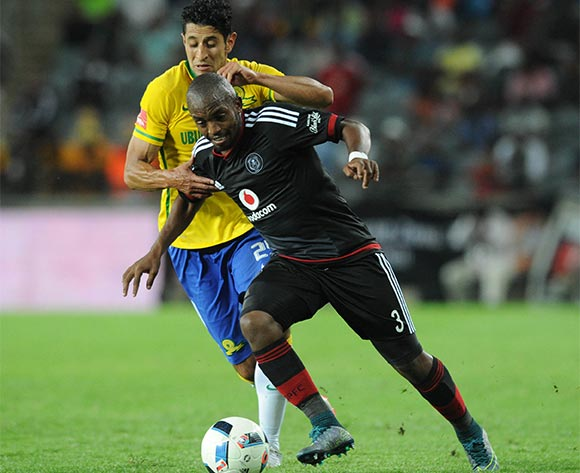 Leonard Castro of Mamelodi Sundowns challenges Patrick Phungwayo of Orlando Pirates during the Absa Premiership match between Orlando Pirates and Mamelodi Sundowns  on 10 February 2016 at Orlando Stadium Pic Sydney Mahlangu/ BackpagePix