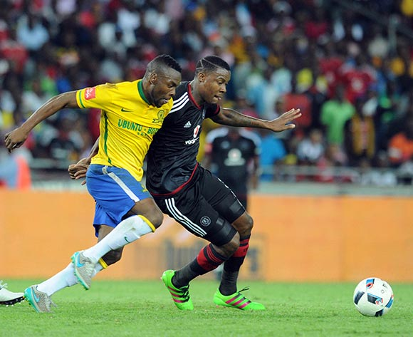 Siyanda Zwane of Mamelodi Sundowns challenges Thamsanqa Gabuza of Orlando Pirates during the Absa Premiership match between Orlando Pirates and Mamelodi Sundowns  on 10 February 2016 at Orlando Stadium Pic Sydney Mahlangu/ BackpagePix